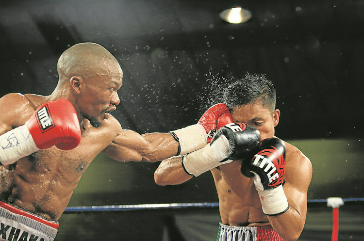 Simpiwe Konkco lands a left to the side of Toto Landero's head during their IBO mini-flyweight title bout in Mthatha last weekend.