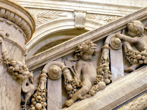 Photo: Carved marble putti on the stairway in the north west corner of the main entrance to the Library of Congress. The first holds a rake and a hoe.
