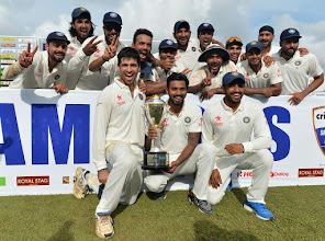 Photo: India's cricket team pose for photographs after their victory during the final day of the third and final Test match against Sri Lanka at the Sinhalese Sports Club (SSC) in Colombo on September 1, 2015. India defeated Sri Lanka by 117 runs in the third and final Test in Colombo to win a series on the island for the first time since 1993. AFP PHOTO / Ishara S. KODIKARA
