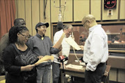 REHEARSING: The cast of Radio Vuka during the recording at SA FM studios in Auckland Park.  PHOTO: BUSISIWE MBATHA