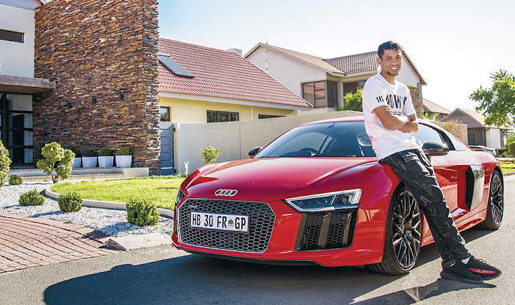 Wayde van Niekerk poses with his Audi R8.