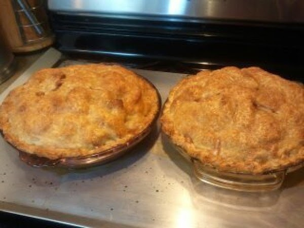 Add top crust to top of apples and seal top crust to bottom crust...