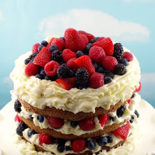 Chocolate Genoise Sponge Cake with Chocolate Mousse, Berries & Whipped Cream Icing.