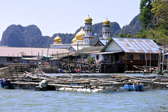 Photo: mosque in a Muslim fishing village built entirely on stilts against the limestone karst island of Koh Panyee in Phang Nga Bay