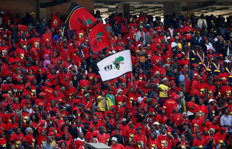 Members of South Africa's Economic Freedom Fighters party (EFF) attend the funeral of Winnie Madikizela-Mandela in Soweto, South Africa April 14, 2018.