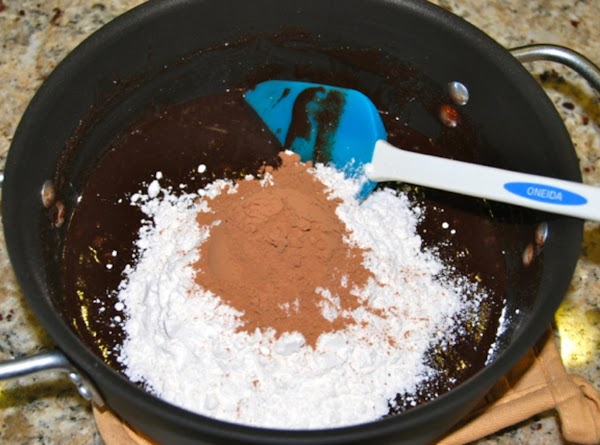 Add the flour and cocoa and beat until incorporated and the mixture is smooth,...