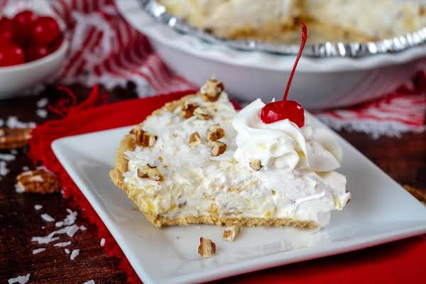 A Slice Of Million Dollar Pie With Cream Cheese On A Plate.
