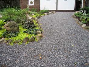 Photo: Black granite gravel sounds beautiful when you walk on it. It also allows rain water to infiltrate instead of flowing into storm sewers.