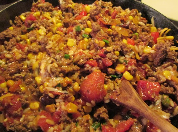 Combine the meat mixture and about 3/4 cup of the cheese, half a can...