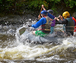 Photo: All hands are needed for this rapid at Jamaica State Park by Linda Carlsen-Sperry.