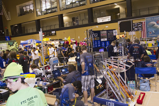 High school teams tinker during the regional FIRST robotics competition in hopes of advancing to the national robotics championship.