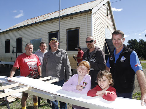 Peter McCauley, Jason Simpson, Don Cunningham, Robert Spencer and Jamie Charlton, with Jason O'Brien, back, and Emily and Jessie Simpson, front,  are among the Narrabri Fishing Club members restoring the Air League hall.