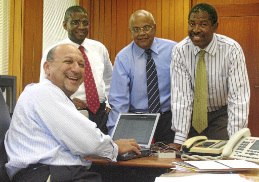 Then finance minister Trevor Manuel in his office with, from left, Jabu Moleketi, Pravin Gordon and Lesetja Kganyago before the 2005 Budget announcement. Picture: TREVOR SAMSON