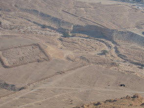 Photo: BIrd flying over ruins of Roman siege camps