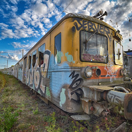 At Rest by Marco Bertamé - Transportation Trains ( sky, rest, wagon, metal, yellow, clouds, cloudy, blue, rails, graffiti, out of order, standstill, train )