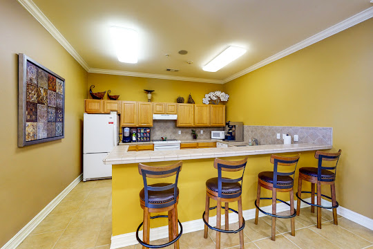 Community clubhouse kitchen with bar stools