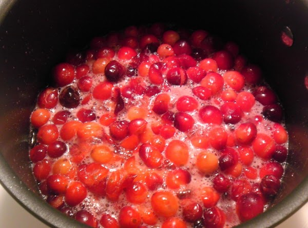 Reduce heat, simmer about 10 minutes, or until cranberries burst.