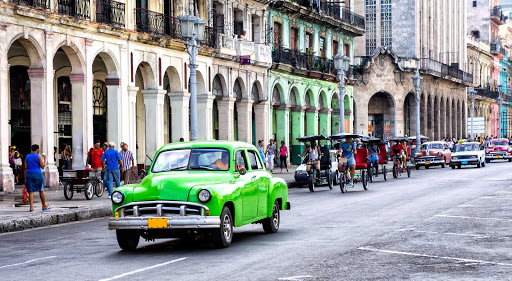 Cuba-Street-with-Green-Car-Peds-Buildings_01.jpg - Pedicabs are the most common way of getting around Old Havana.