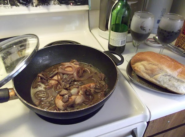 Serve with crusty french bread, and the same wine you used to cook chicken. YUMMM.