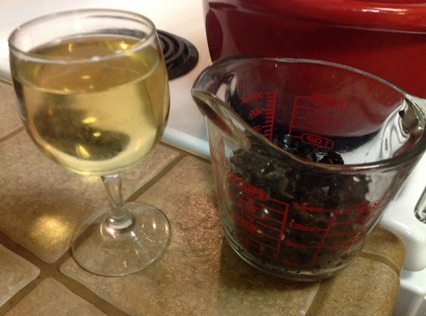 Add a glass of wine and chopped black olives.