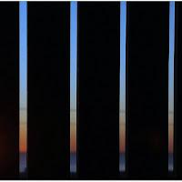 Il tramonto dietro la grata di