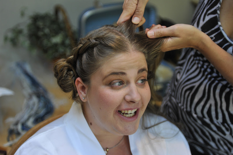 Photo: Tarena braids Kelly's hair