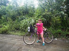 Photo: Charlotte bike riding through the wilds outside Puerto Jimenez