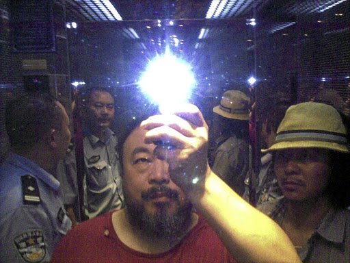 Dissident Chinese artist Ai Weiwei takes a selfie during his arrest.