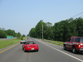 Photo: chase vehicles follow the first group as they make their way to the next stop