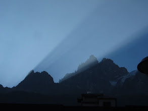 Photo: Early morning light streams through the Grandes Jorasses, the same jagged peaks that we saw lit up last night.