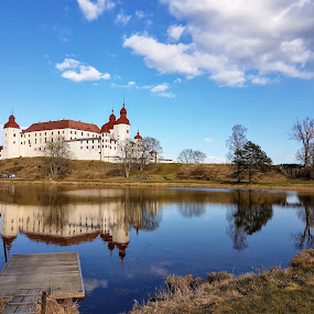 Castle by the lake by Eva Larsson - Landscapes Waterscapes ( castle clouds reflecting water lake countryside spring sweden fairytale trees )
