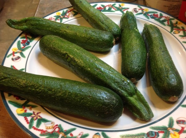Wash the zucchini or squash thoroughly, then add to a large pot, and cook...