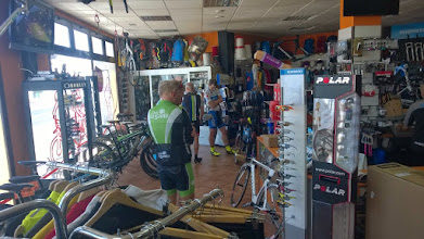 Photo: And checking out better bikes in the bike store next door.