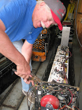 Photo: Peter Bryan stripping nuts on wiring after fixing the joint he pulled out.