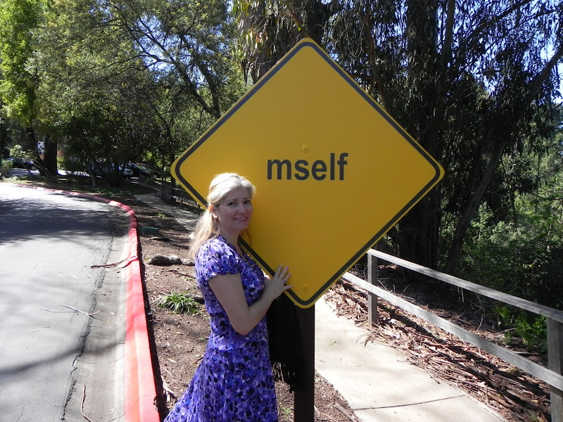 """Photo: Elena Martina shared this picture of herself next to """"mself"""" - part of """"404: Text Road Poem (The Divine Comedy),"""" by Seyed Alavi. Week of April 6, 2012."""