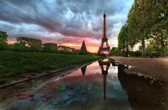 Photo: Reflections on the Eiffel Tower   There was a big storm all day long, but I could see the clouds were beginning to break up a little to the west, and I knew there was a possibility the sun would dip into an opening beneath the heavy clouds. So, with that intense possibility, I headed over to the Eiffel Tower area hoping the light would turn out right...    /private dedication from ec to mm.  from Trey Ratcliff at http://www.StuckInCustoms.com