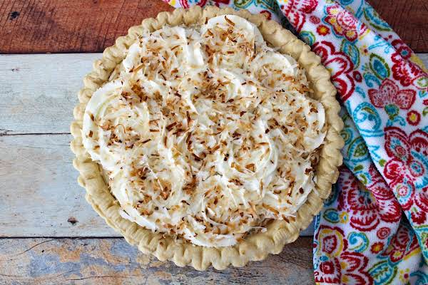 Old Fashioned Coconut Cream Pie Ready To Be Sliced.
