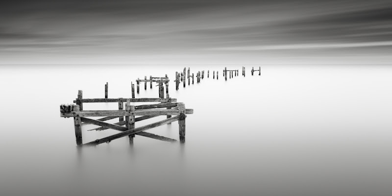 """Photo: Well it's been done before, but no trip to Dorset would be complete without paying a visit to the old pier in Swanage. Dorset is a location that I've been wanting to get to for about 3 years now and I can't believe it's taken me that long to pull my finger out to get down there, rest assured it won't be 3 years until the next visit.  Even though this location has been shot so many times, I did a little research before I went and most of the shots I've seen are in 1:1 format. So wanting to do something a little different I've opted for the 2:1, but no doubt there will be a square from me at some point.  Have had trouble with naming this one so far, as all the good titles have been taken by those that have stood here before and inspired me, ie: All That Remains, Remnants etc etc... So if anyone has got any suggestions I'll be happy to part with 12x6"""" print of this.  Myself and Doug Chinnery have some places available on our long exposure workshop in (and around) Whitby on 10th March. If you are interested, then please let me know or go to: www.dougchinnery.com"""