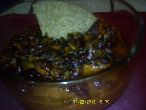 To serve:  Spread into bowl evenly, top with broken up toasted walnuts, parsley, and drizzle...