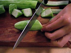 Photo: roll-cutting loofah squash
