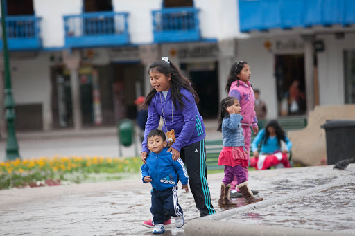 Local kids playing at Plaza De Armas in the center of Cusco, Peru.