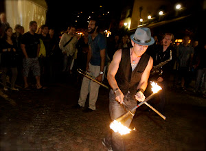 Photo: Fire Juggling with Re-Generation Brass Band