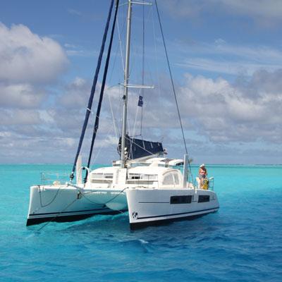 catamaran anchored in turquoise water
