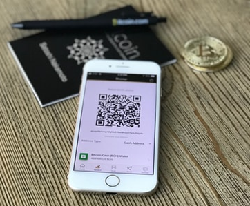 Bitcoin QR code scanned for transactions