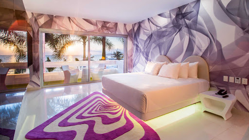 The 153 Trendy Garden View rooms at Temptation Cancun Resort feature a king size bed, intimate living area with a 48-inch LED TV and a bathroom with a refreshing rain shower.