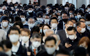 People wearing protective masks, following the coronavirus disease (Covid-19) outbreak, make their way at Shinagawa station in Tokyo, Japan November 13, 2020.