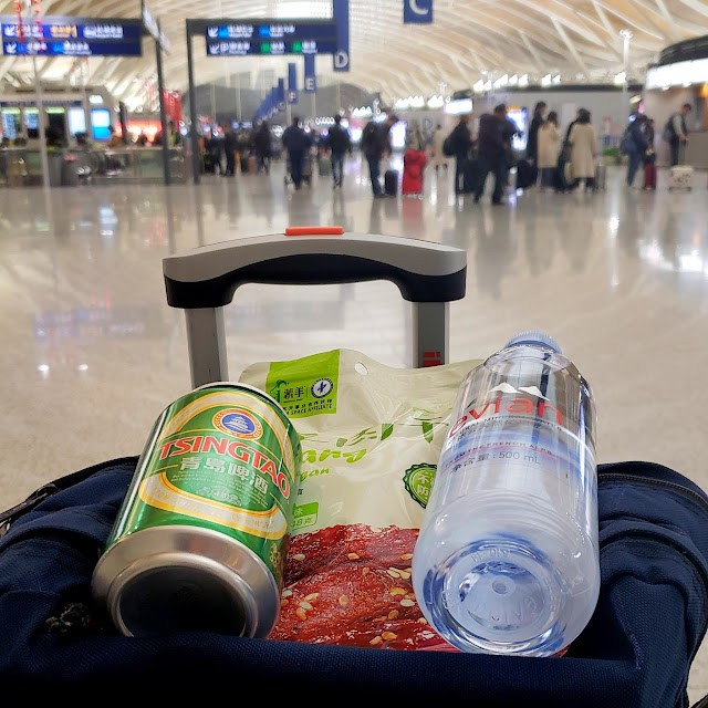 Chinese beer and jerky for dinner at the Shanghai airport