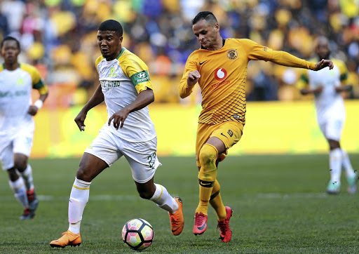 Lyle Lakay (L) of Mamelodi Sundowns pulls away from Kaizer Chiefs striker Gustavo Paez during the Absa Premiership on August 4 2018.