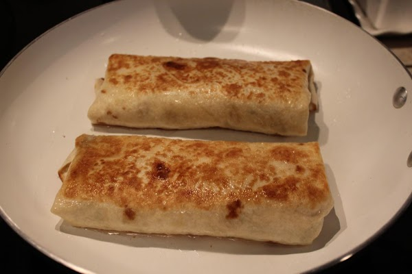 Heat oil in a pan and cook burritos on each side to a nice...