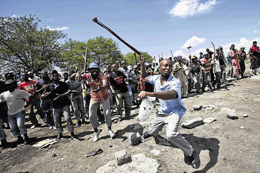 JOB HUNTERS: Protesters at Anglo Platinum's Jabulani Mine in Rustenburg, North West, demand to be reinstated yesterday, when the Marikana commission of inquiry considered police footage from the day in August that 34 miners were shot dead.